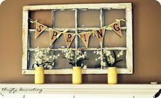 Thrifty Decorating: Finally....I put up a spring mantle painted Ball jars, dollar store flowers, brown paper banner