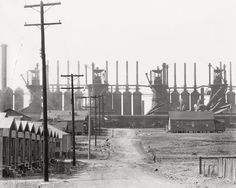 walker evans:  Birmingham Steel Mill And Workers' House, 1936
