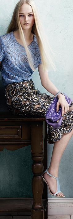 British model Jean Campbell wearing a metallic blue gem-embellished pencil skirt and The Petal bag with transparent flowers in the Burberry S/S14 campaign