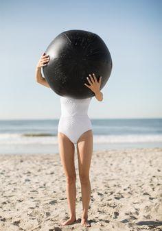 Alexander Wang beach ball, Baba Jaan white swimsuit / Garance Doré