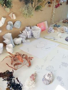 Julie Blyfield's workshop and works in progress - jewelry maker, love to see her paper models at back
