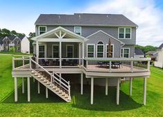 This custom deck & porch combo was designed and built to create more usable living space for the homeowner. Pull up a chair at the custom curved bar top or Outdoor Deck Decorating, Porch Decorating, Decorating Ideas, Outdoor Decor, Porch Kits, Raised Patio, Deck Construction, Deck Stairs, Building A Porch