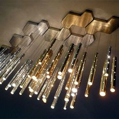 The Rain Chandelier by Ilanel Design Studio: This dual purpose fixture is both a light and a set of chimes. The long perforated aluminum tubes emit glistening light while also acting as a beautiful, serene chime fixture. Interior Lighting, Home Lighting, Modern Lighting, Lighting Design, Luxury Lighting, Lighting Ideas, Modern Lamps, Luxury Decor, Industrial Lighting