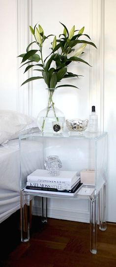 Bright White Bedroom With Acrylic Furniture Accents.                                                                                                                                                                                 More