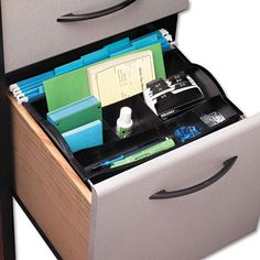 This Rubbermaid desk drawer organizer suspends from hanging file rails. Shallow front sections hold paper clips and other tiny items, while large back sections hold oversized items like discs, pens an