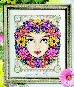 """""""Summer Goddess"""" © Joan A. Elliott photo - ©Neil Goodwin Cross Stitch Collection ~ """"Coming in Issue 191 of 'Cross Stitch Collection,' a beautiful 'Summer Goddess' inspired by the flowers growing in my Vermont garden. What a joy to be able to once again combine  my 2 most loved activities, designing & gardening. I love the riot of color in the summer garden. Black-eyed-susans, cosmos, pincushion flowers & lilies abound to bring a fresh & vibrant lift to the design."""" -Joan Elliott"""