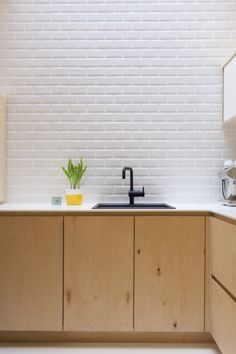 White tile, wooden cabinets