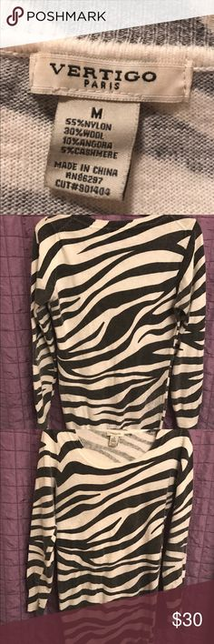 💕Vertigo Paris Zebra blouse 💕Authentic wool and cashmere Zebra long sleeve shirt. Has a small stain on left sleeve 😭 possibly can be removed..Dry clean only. Limited Edition and will go fast! Vertigo Paris Tops Blouses