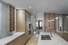 North Toronto addition project began as a simple addition to the rear of a two storey detached house in Bedford Park. Bedford Park, Light Hardwood Floors, Simple Addition, Stone Slab, Undermount Sink, Wood Cabinets, Detached House, Modern Architecture, Toronto