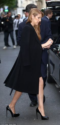 Finishing touch: Celine added a pair a of towering black heels to her chic outfit...