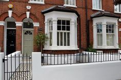 Front garden wall painted white metal wrought iron rail and gate Victorian mosaic tile path in black and white Scottish pebbles York stone Balham London - London Garden Design Victorian Front Garden, Victorian Terrace Interior, Victorian Townhouse, Victorian Gardens, Terrace House Exterior, White Exterior Houses, Facade House, Garden Design London, London Garden