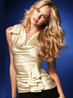 beautiful satin top to wear with jeans, business suit or evening wear with a skirt.