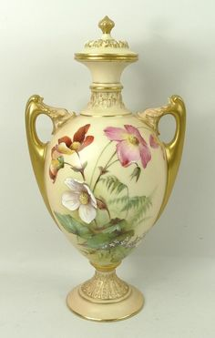 Royal Worcester blush porcelain vase and cover, circa 1901, of twin handled, baluster form painted with wild flowers, shape no 2158, printed marks, 29cm high.