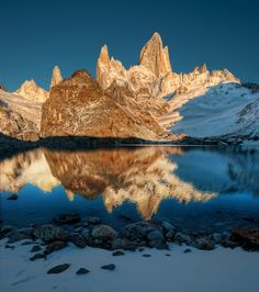 <h2>A Morning at the Secret Lake</h2> <br/>This was shot in the Andes of Southern Argentina just near the border of Chile.<br/><br/>I spent several hours of hiking in the dark just so I could get to this spot at sunrise.  All the darkness in the lower half is the shadow of the mountain behind me as the morning sun rose above it.  I was so thirsty from the hike, and had not brought any water with me.  Looking on Google Earth beforehand, I knew there was a lake up here and I could fill up… so…