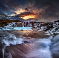 Brúarárfoss on the Golden Circle. Most shots of this one are static, just showing the waterfall. This one uses slow shutter speed to create foreground motion. The sunset above takes it to the next level.