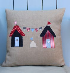 A fun cushion inspired by many trips to the great British seaside. Made from natural linen with button detailing on the reverse. Cushion measures x and has a generously filled duck feather insert. British Beaches, Applique Cushions, Beach Huts, Sewing Crafts, Sewing Ideas, All Craft, Soft Furnishings, Bunting, Castle Decorations
