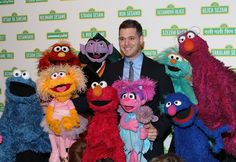 It looks like he's ready to sing of happy, not sad. Michael Bublé attends the 12th annual Sesame Workshop benefit gala with a few good Muppets on May 28 in New York