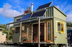 This incredible off-the-grid tiny house on wheels allows its residence to live a full and happy life without having to worry about utility bills.