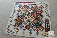 Retta pieced this and Natalia Bonner machine quilted it for her.  Pattern is Saltbox Sampler by Amy McClellan of Under the Garden Moon & American Quilting. I love this quilt, I am making one with the same blocks, but just changed up the layout.