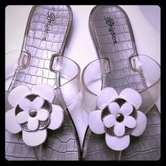 Brighton sandals shoes Adorable and comfortable white, clear, and silver signature trim. The size is marked as 9-10. Brighton Shoes Sandals