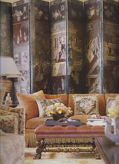 Love this coromandel screen as a backdrop for the gorgeous sofa and ottoman.