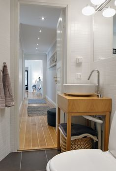 Grey floor tile, light wood, white (Bathroom color palate)