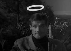 The Saint was an ITC mystery spy thriller television series that aired in the UK on ITV between 1962 and 1969. It centred on the Leslie Charteris literary character Simon Templar, played by Roger Moore as a suave and sophisticated Robin Hood-like adventurer. The character may be nicknamed The Saint because the initial letters of his name (ST) are also an abbreviation for the word saint. When taking on an American persona, he would often use the name Sebastian Tombs. White Tv, Black And White, Literary Characters, Roger Moore, Initial Letters, Adventurer, James Bond, His Eyes, About Uk