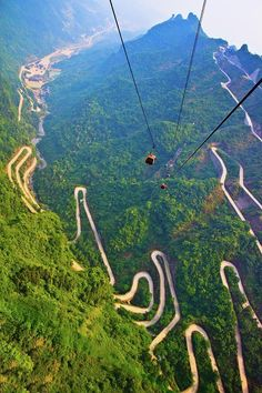 The mountains and winding road in Mount Tianmen, National Forest Park in western Hunan province of China / Les routes sinueuses de montagne du Mont Tianmen, parc national du Hunan, Chine Zhangjiajie, Places To Travel, Places To See, Travel Destinations, Travel Trip, Places Around The World, Around The Worlds, Dangerous Roads, Winding Road