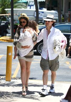 Tom Cruise celebrating Father's Day 2011 with a boat trip. Then wife Katie Holmes held daughter Suri, who probably got tired of walking in heels after an afternoon yacht adventure.