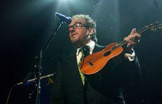 Elvis Costello plays ukulele