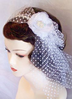 Bridal Pearl Headband featuring Dotted Swiss Tulle and a white organdy flower with a crystal rhinestone center.  $69.00  www.ReneeBurroughsDesign.etsy.com