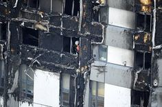 A firefighter is seen in a lower window of the burning 24 storey residential Grenfell Tower block