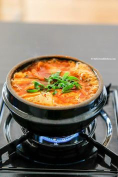 The classic Kimchi Jjigae (Kimchi stew) recipe with some fatty pork. When the fat from the pork melts into the soup, it becomes irresistibly delicious!   MyKoreanKitchen.com