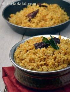 """This tongue-tickling rice treat is prepared with readily-available ingredients, but has an unforgettable flavour and pleasing texture.    The key ingredients, which endow this <a href=""""recipes-for-south-indian-44"""">South Indian</a> Stir-Fry Rice with such irresistibility, are sesame seeds and peanuts. These ingredients are perfectly complementary to the rustic tanginess of tamarind, and together, they make this stir-fried rice recipe a perfect winner!   Eat with <a href=""""Cucumber-Pachad..."""