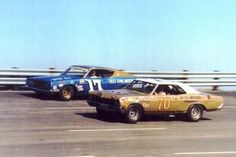 1968. Eventual champion David Pearson passes somebody's old Buick. Whoosh!