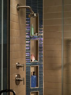 The pop of iridescent glass really accentuates this shower!