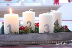 advent candles: simplicity. I like the pillars. Use berry picks with pine cones & holly or pine branches.