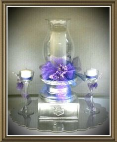 One of 12 different wedding center pieces purple and royal blue