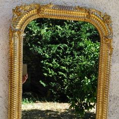 French gilded mirror, miroir ancien doré à la feuille d'or. Antique mirror gilted with gold leaf