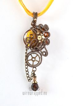 Steampunk wire wrapped main bead is silver foil glass in the shade of amber yellow. The wire is enamel plated copper. The small beads are fire polished glass and brass. The