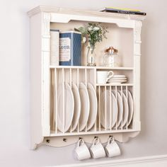 This high quality wooden French country style plate rack is reminiscent of antique French furniture finds one would probably find in rural French markets. The wall mounted plate rack is a stylish way to store and display your plates and is finished in a subtle white shade with a distressed edge and natural wood coping along with a plate rack for large dinner plates as well as a plate holder for side plates or dessert plates.