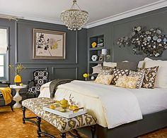 Charcoal + Yellow Charcoal gray wraps this bedroom in a cozy cocoon. Set against a dark background, pops of yellow seem even more sunny and cheerful. Contemporary and traditional elements converge just as comfortably as the contrasting colors. Above the bed, mirrored artwork plays off the traditional crystal chandelier. Bold patterned fabrics cover classically styled furnishings.