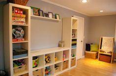 playroom storage. Expedit Ikea shelf. 5 cubby tall, and 8  cubby for lower piece.