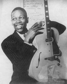 Charlie Christian autographed photo with Gibson ES-250