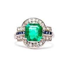Vintage Emerald Engagement Ring | Spencer I love low profile rings.  And emerald cut anything.  And sapphires.  And emeralds.  In short, this ring is PERFECTION!