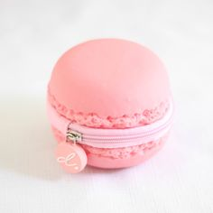 The strawberry scented macaron coin purse provides a fun way to keep your cash organized and at hand.