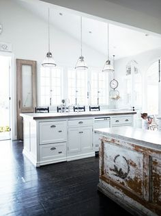 I like white! I like bright! I like tall ceilings! Great white kitchen with wood floors and large island and a load of windows. Maybe there is a stove or refrigerator. Who cares?