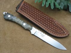 Neilson's Mountain Hollow Custom Knives' Small Game Knife in Buckeye Burl. Forged from 1084 steel.