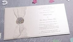 Abigail invitation with lace, filigree ivory paper and a large diamanté embellishment from www.ajoytobehold.co.uk