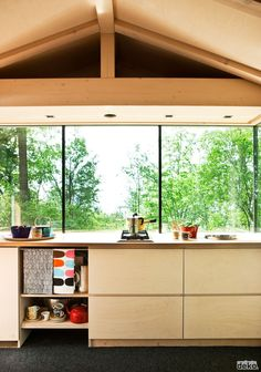 Cottage kitchen and large windows is a welcome. Come in and enjoy the view of our forest.